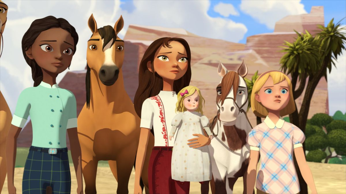 three girls and their horses