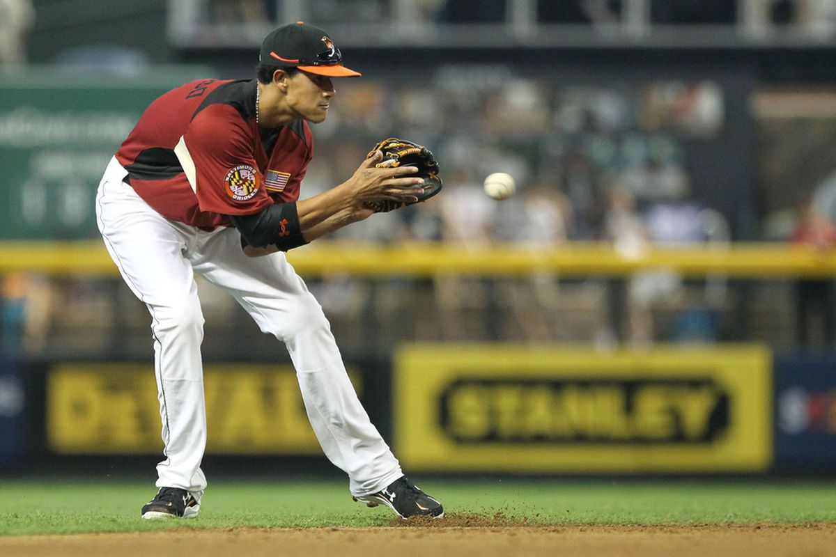 PHOENIX, AZ - JULY 10:  U.S. Futures All-Star Manny Machado #3 of the Baltimore Orioles field a ground ball during the 2011 XM All-Star Futures Game at Chase Field on July 10, 2011 in Phoenix, Arizona.  (Photo by Jeff Gross/Getty Images)
