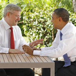 In this Nov. 13, 2011, file photo, Canadian Prime Minister Stephen Harper, left, talks with U.S. President Barack Obama following the first plenary session of the Asia-Pacific Economic Cooperation summit in Kapolei, Hawaii.