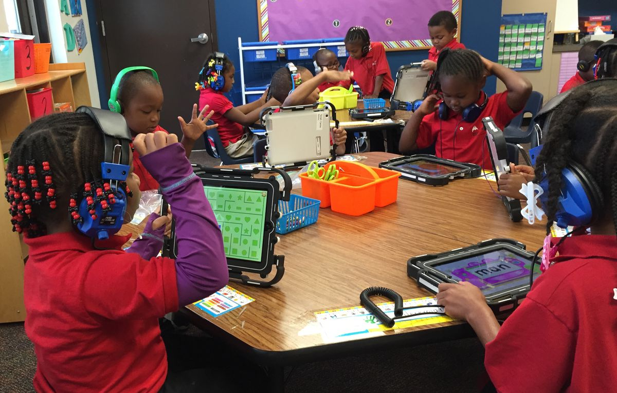 While older kids at Michigan Technical Academy do their work on laptops, kindergarten and first-grade students use tablets.