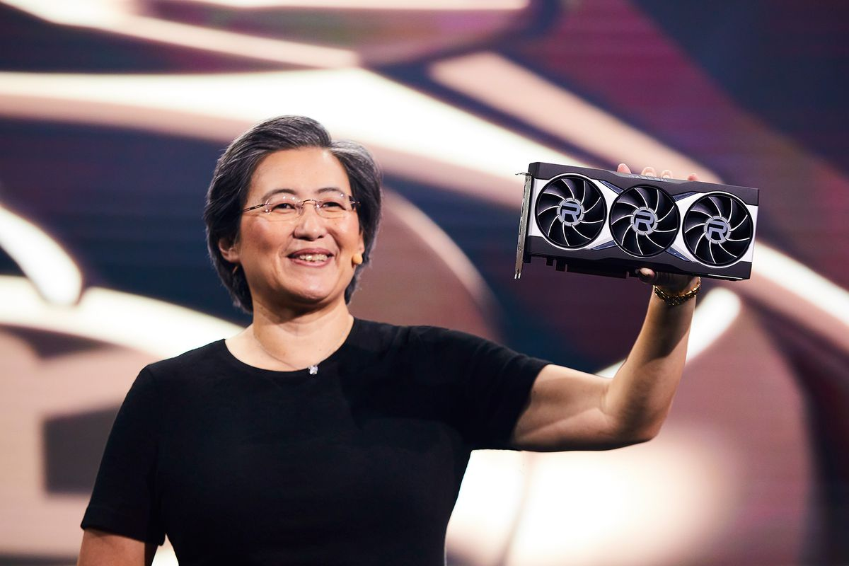 AMD CEO Dr. Lisa Su holding up the AMD Radeon RX 6800 XT graphics card on stage
