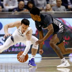Brigham Young Cougars guard Alex Barcello (4) steals a loose ball from Santa Clara Broncos guard Tahj Eaddy (2) at Brigham Young University in Provo on Thursday, Feb. 20, 2020.