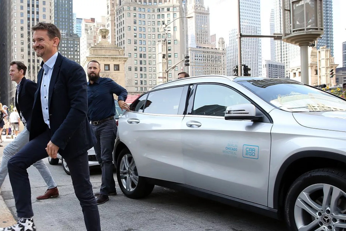Car2Go CEO Olivier Reppert steps out of a car from the rental program's pilot Chicago fleet at a launch event in Pioneer Court last year.