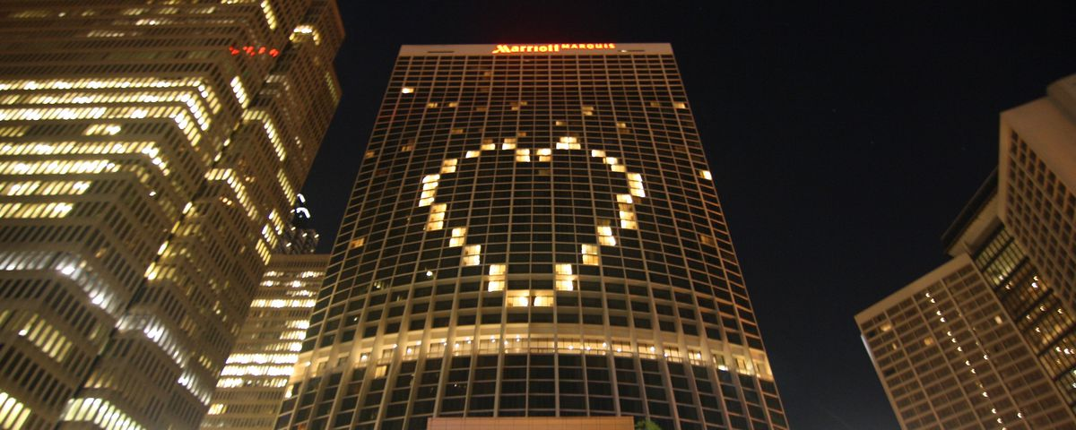 A hotel with a large heart on if made from dormant rooms.