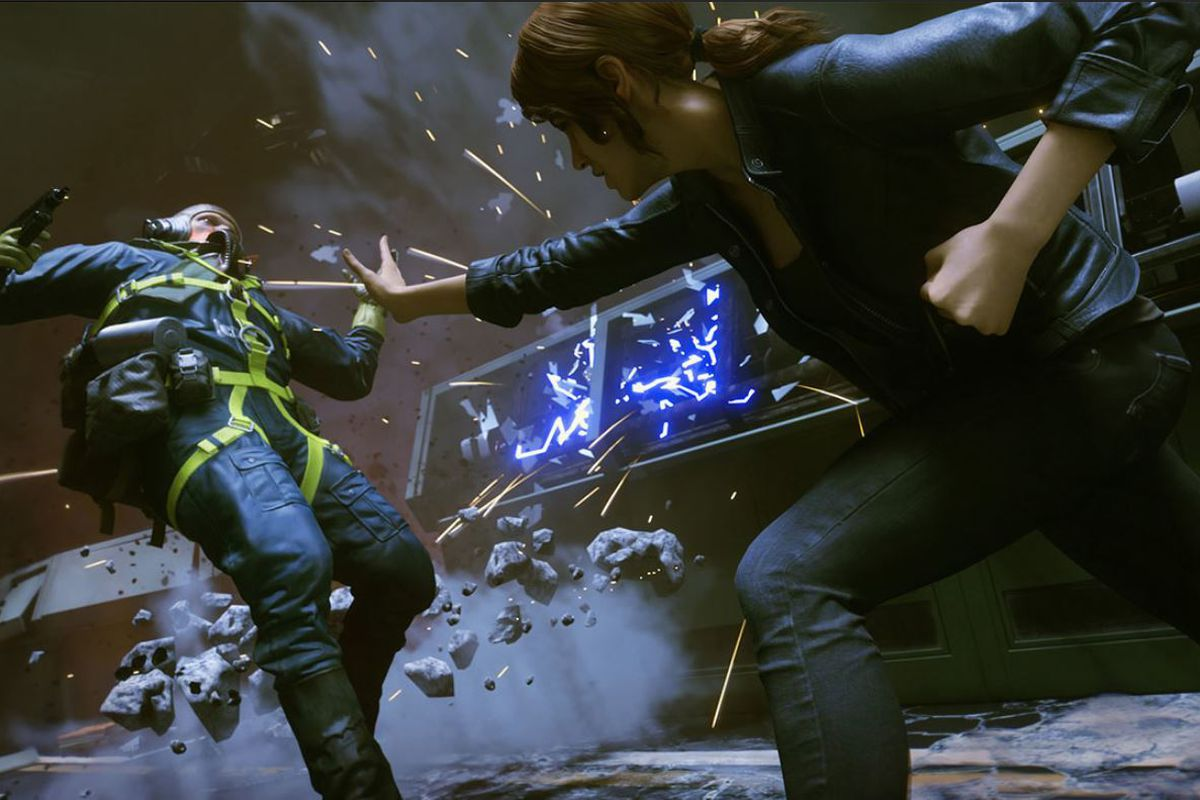 The main character in Control lashes out with her mind, throwing an enemy through a cloud of debris.