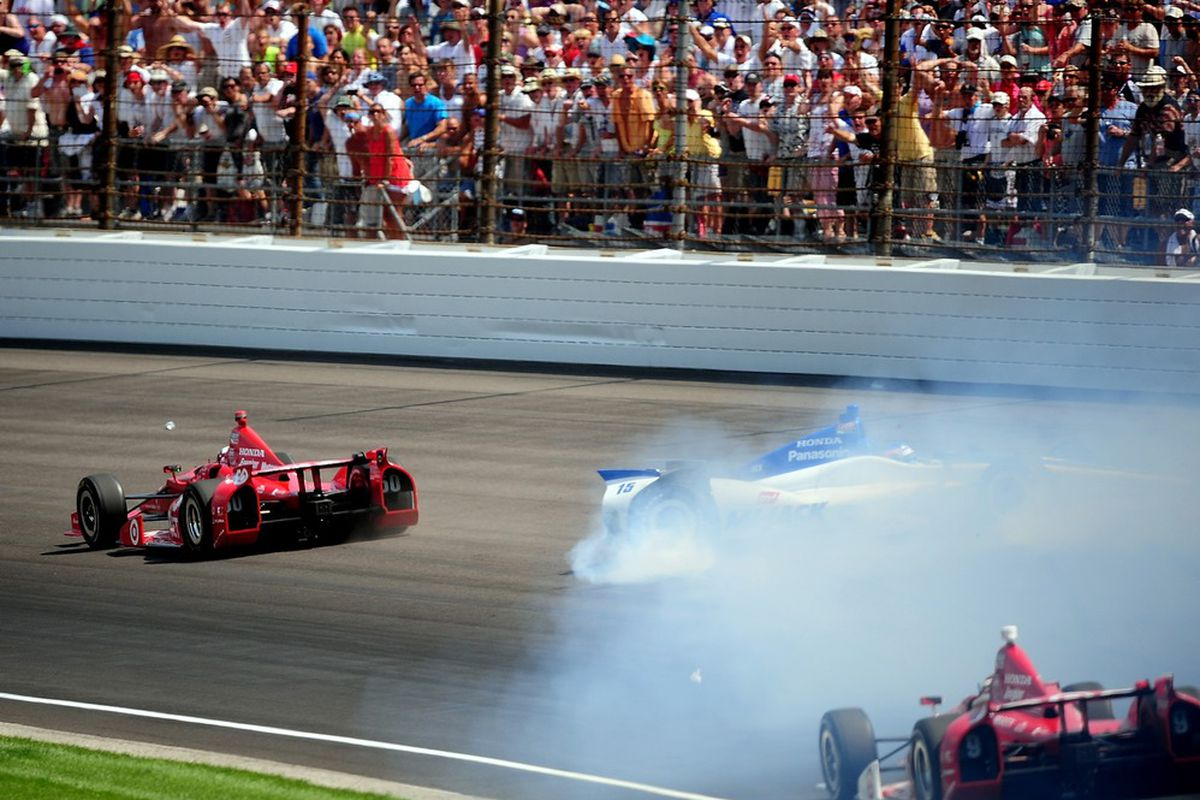 May 27, 2012; Indianapolis, IN, USA; IndyCar driver Dario Franchitti (50) gets past Takuma Sato (15) as Sato crashes into the wall on the last lap of the Indianapolis 500 at the Indianapolis Motor Speedway. Mandatory Credit: Andrew Weber-US PRESSWIRE