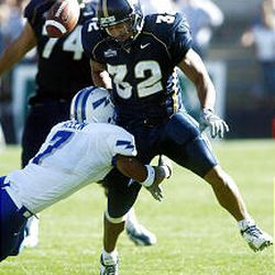 Air Force's Nate Allen knocks the ball away from BYU's Marcus Whalen to stop a Cougar drive late in the 4th quarter.