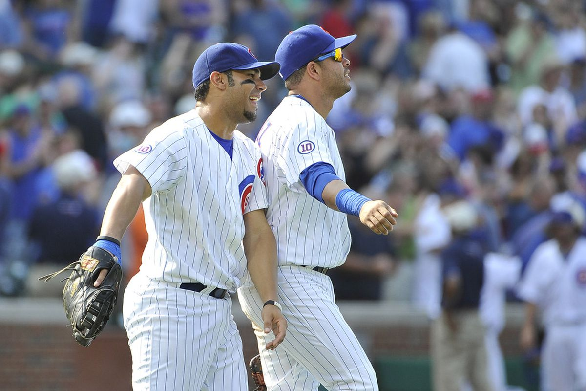 Carlos Pena and Aramis Ramirez of the Chicago Cubs celebrate their win over the Colorado Rockies at Wrigley Field in Chicago, Illinois. The Cubs defeated the Rockies 7-3.  (Photo by Brian Kersey/Getty Images)