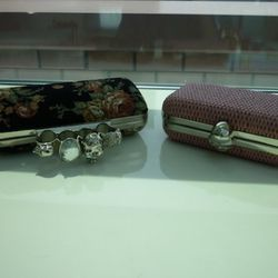 The goth-y statement ring handle on the clutch on the left is cute.