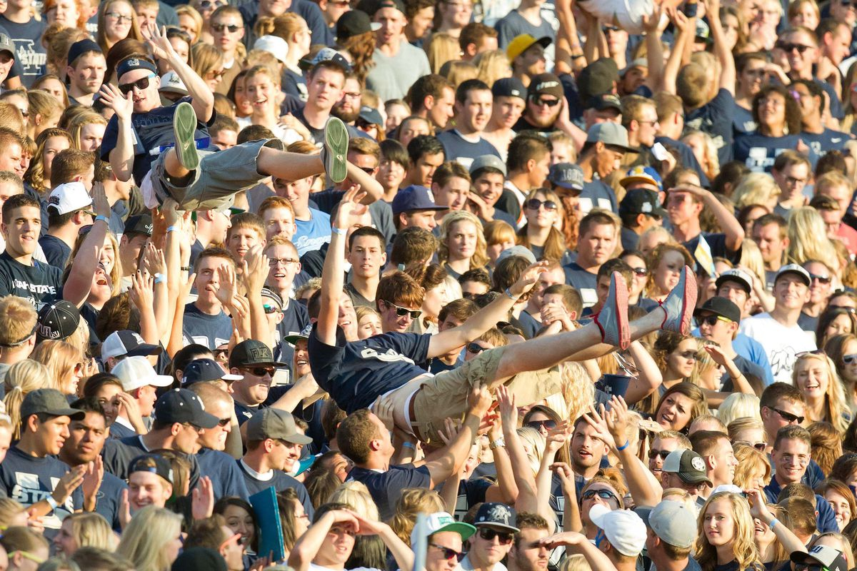 September 7, 2012; Logan, UT, USA; Utah State fans crowd surf during the first half of a game against the Utah Utes at Romney Stadium.  Mandatory Credit: Russ Isabella-US PRESSWIRE
