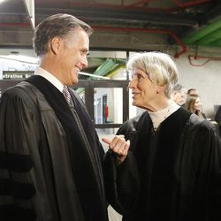 Former presidential candidate and Massachusetts Gov. Mitt Romney talks with Pamela Atkinson prior to commencement at  Utah Valley University in Orem on Thursday, April 30, 2015.