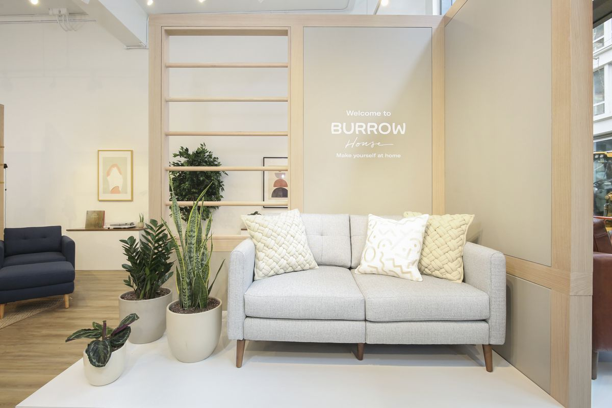 Gray couch next to wall in showroom