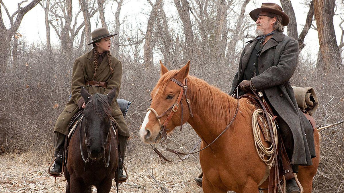 mattie ross and rooster cogburn, both on horseback