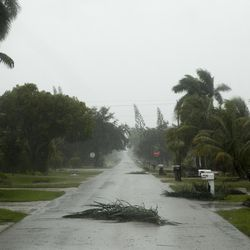 Downed power lines, felled trees, branches, and other debris litter Naples, Fla. as Southwest Florida prepares for Hurricane Irma to make landfall midday Sunday, Sept.10, 2017.