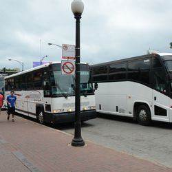 11:08 a.m. More charter group buses pull up on Addison, in front of Captain Morgan Club -