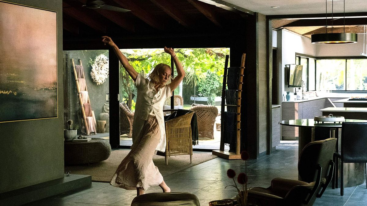 Dressed in white, Jena Malone dances in an otherwise empty house.