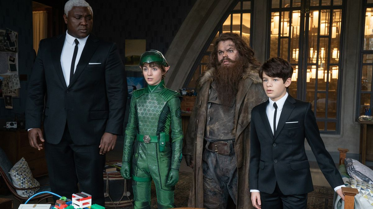 two normal humans bookend a fairy in green armor and a dwarf covered in dirt