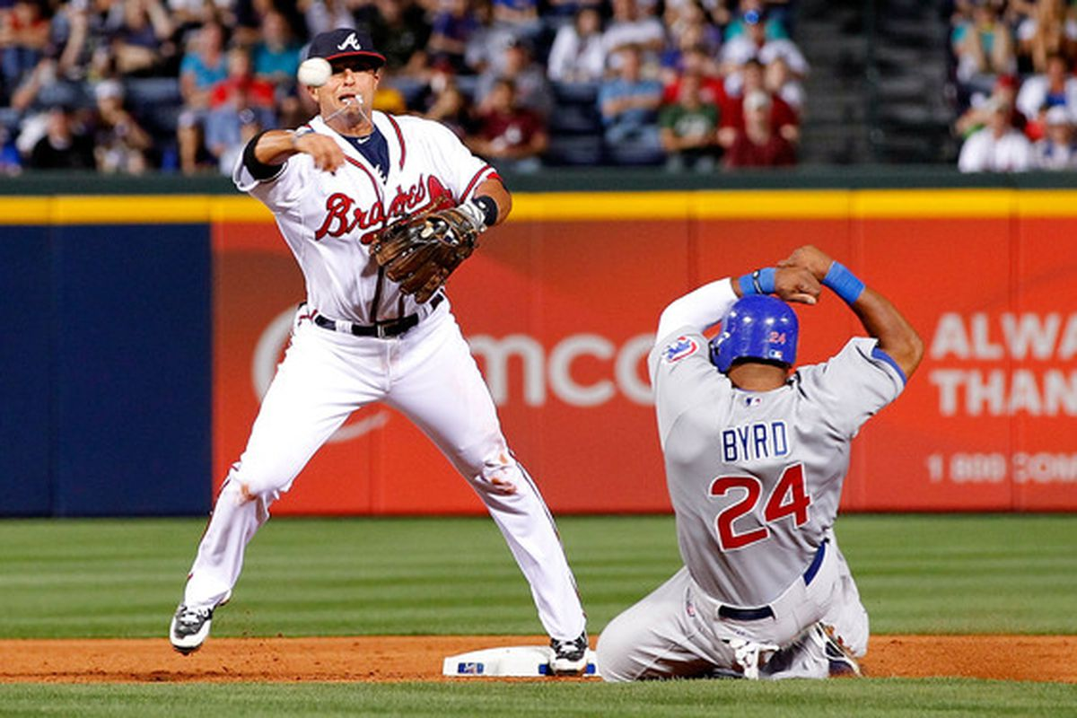 ATLANTA - APRIL 07:  Martin Prado #14 of the Atlanta Braves attempts to turn a double play over Marlon Byrd #24 of the Chicago Cubs at Turner Field on April 7, 2010 in Atlanta, Georgia.  (Photo by Kevin C. Cox/Getty Images)