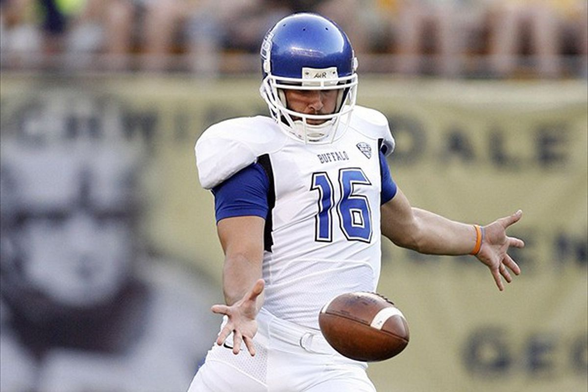 Buffalo Bulls punter Jake Schum (16) punts the ball to the Pittsburgh Panthers during the first quarter at Heinz Field.