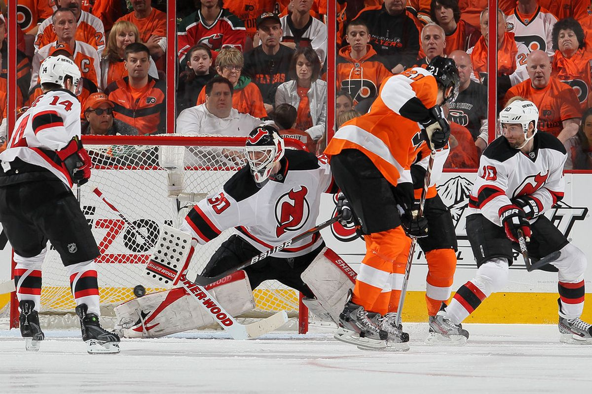 Pictured: Martin Brodeur making a save, Adam Henrique not really covering anyone, James van Reimsdyk open, and Peter Harrold on the wrong side of his man.  (Photo by Jim McIsaac/Getty Images)