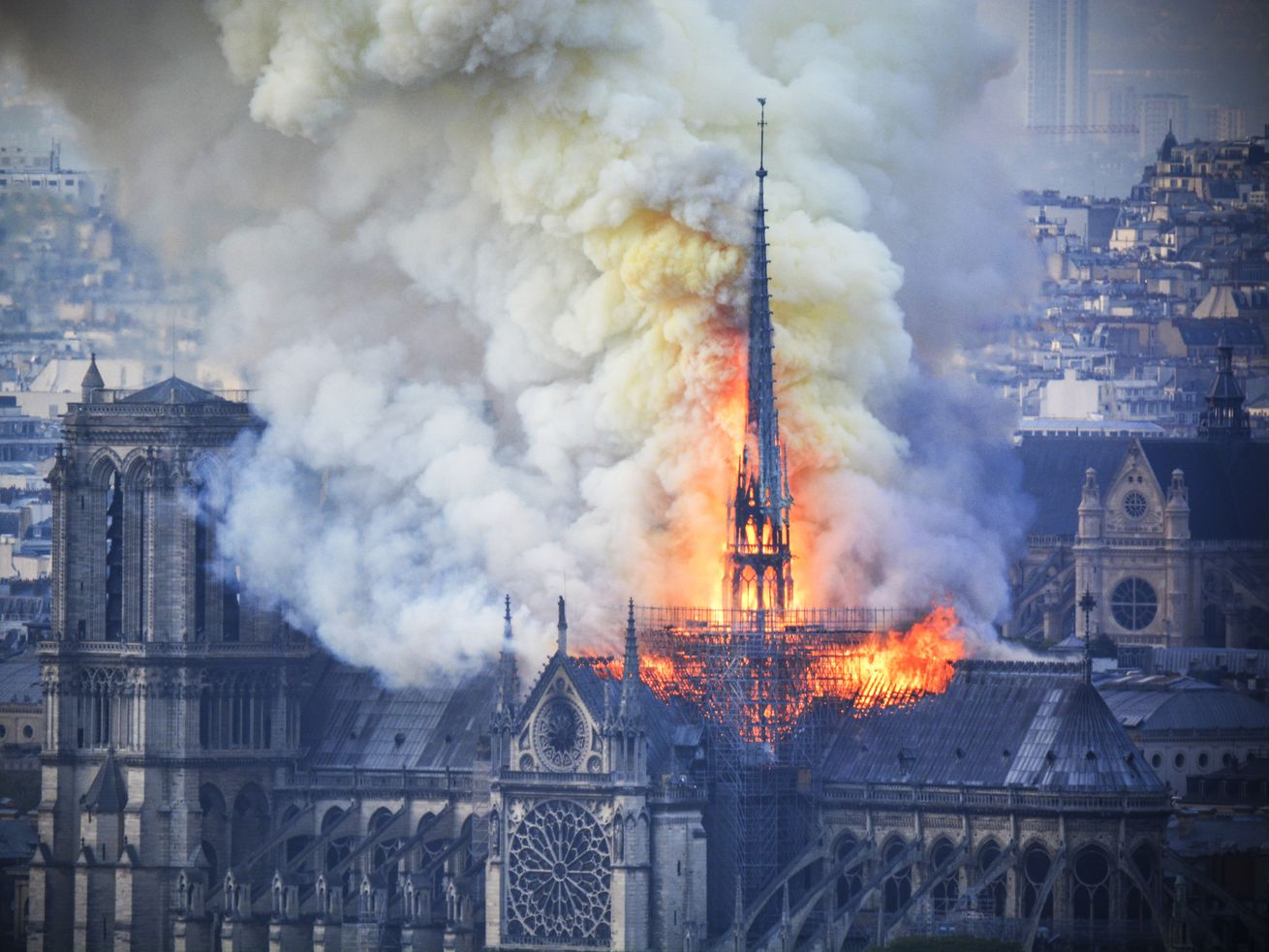 Smoke and flames rise during a fire at the landmark Notre Dame Cathedral in central Paris, France, on April 15, 2019.