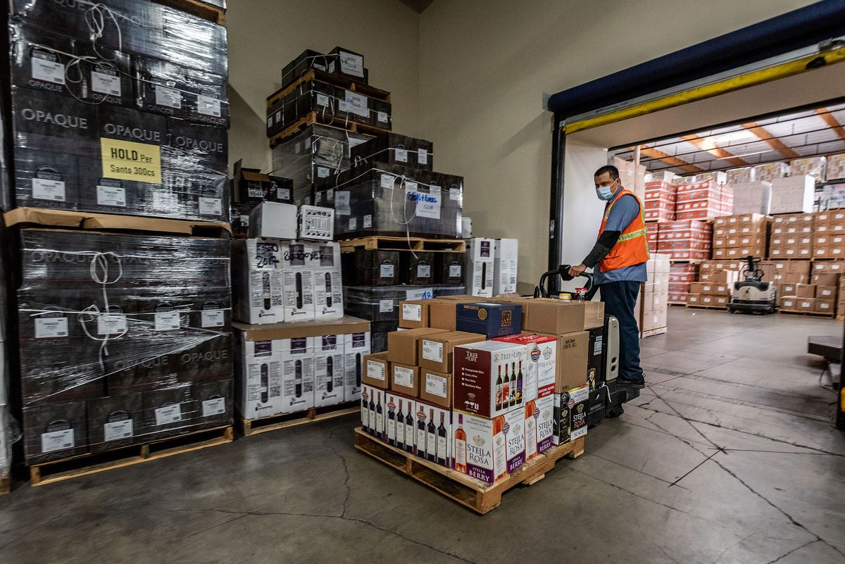 An employee ships cases of wine at San Antonio Winery in Los Angeles