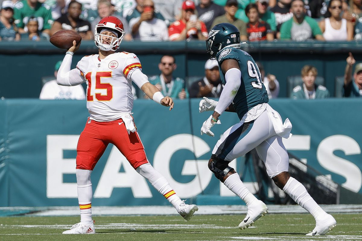 Patrick Mahomes #15 of the Kansas City Chiefs passes as he's pressured by Josh Sweat #94 of the Philadelphia Eagles at Lincoln Financial Field on October 03, 2021 in Philadelphia, Pennsylvania.