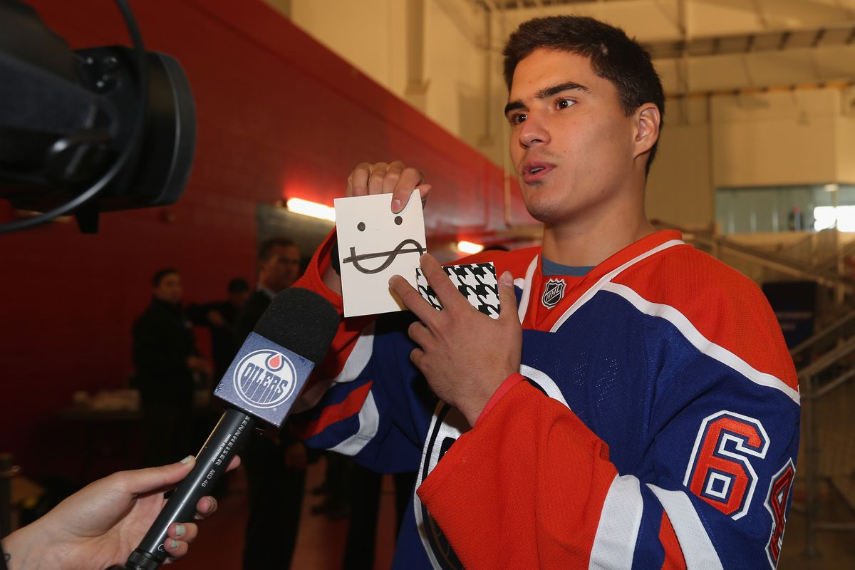 TORONTO, ON - AUGUST 28: Nail Yakupov #64 of the Edmonton Oilers clowns around for the media at the 2012 NHLPA rookie showcase at the MasterCard Centre on August 28, 2012 in Toronto, Canada.  (Photo by Bruce Bennett/Getty Images)