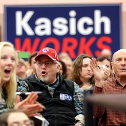 Crowd members cheer as they listen to Ohio Gov. John Kasich speak in the Grande Ballroom at UVU Friday, March 18, 2016.