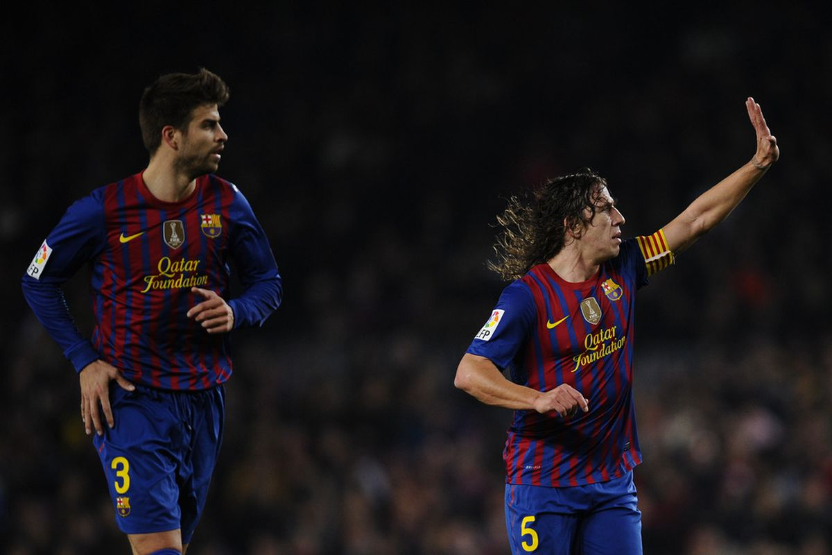 If only we could start these two together...Pique at LCB and Puyol at LB?