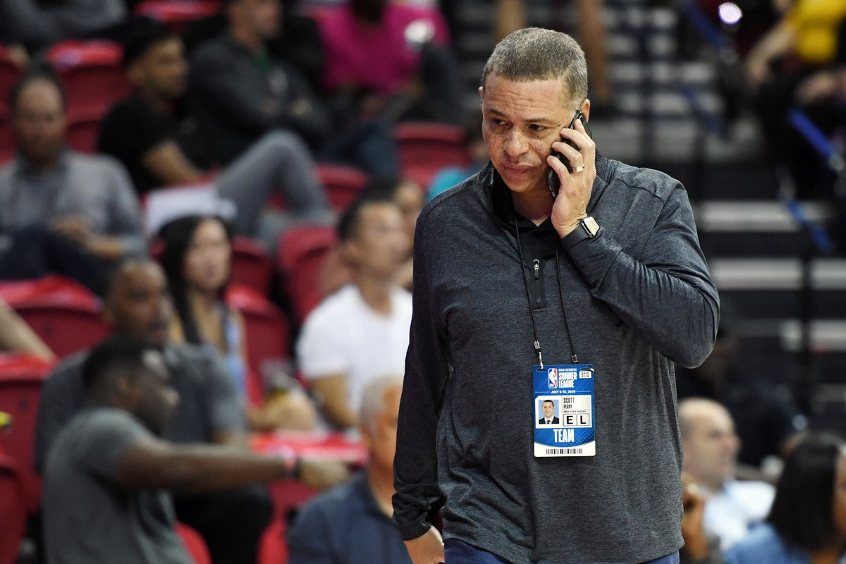 General manager Scott Perry of the New York Knicks talks on a phone as he attends a game between the Knicks and the Phoenix Suns during the 2019 NBA Summer League at the Thomas & Mack Center on July 7, 2019 in Las Vegas, Nevada.