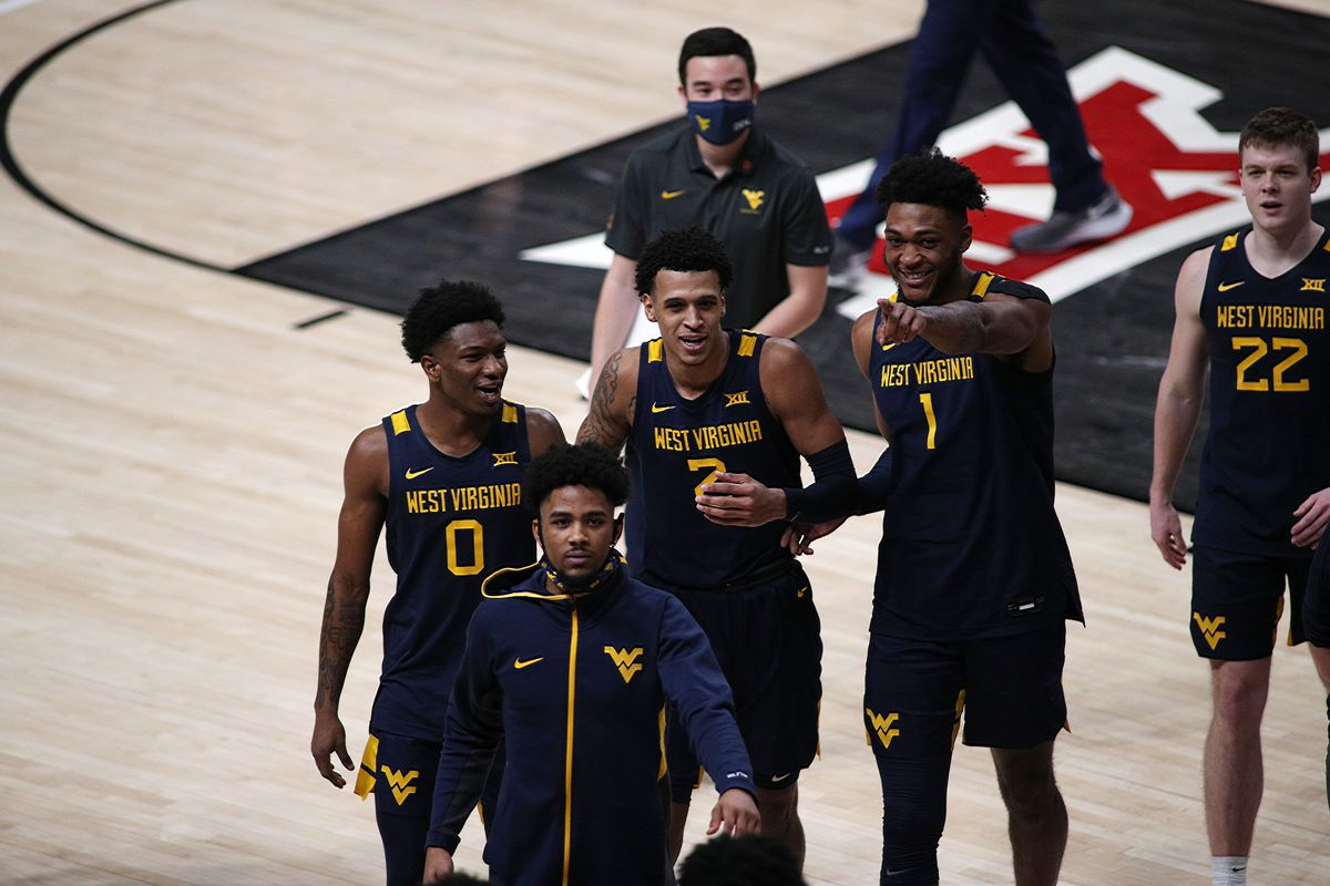 The West Virginia Mountaineers react after the game against the Texas Tech Red Raiders at United Supermarkets Arena.
