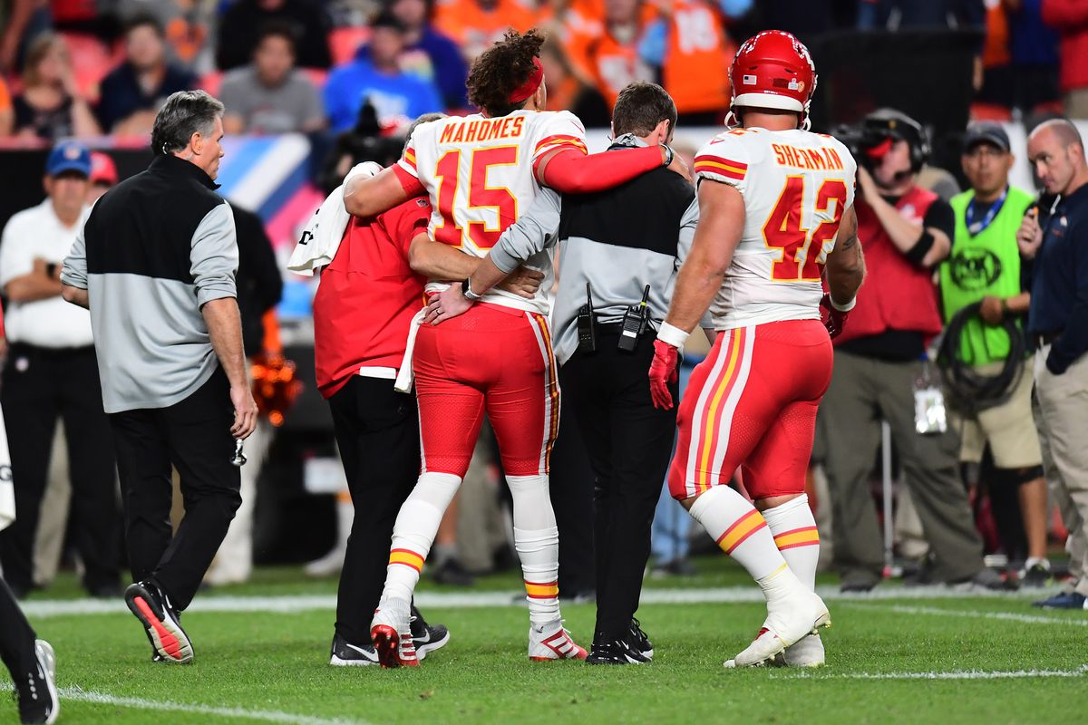 Kansas City Chiefs quarterback Patrick Mahomes comes off the field following an injury in the second quarter against the Denver Broncos at Empower Field at Mile High.