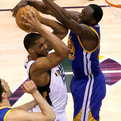 Utah Jazz forward Derrick Favors (15) tries to shoot as Golden State Warriors forward Draymond Green (23) guards him during game 4 of the second round of NBA playoffs at the Vivint Smart Home Arena in Salt Lake City on Monday, May 8, 2017.