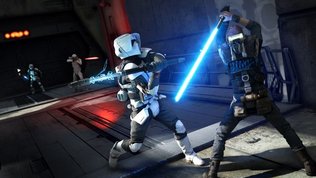 Cal Kestis, with a blue lightsaber, fights off an Imperial Scout Trooper wielding an electro baton