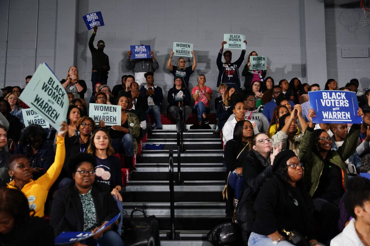 Attendees cheer and hold signs as Sen. Elizabeth Warren (D-MA), speaks at a campaign event at Clark Atlanta University on November 21, 2019 in Atlanta, Georgia.