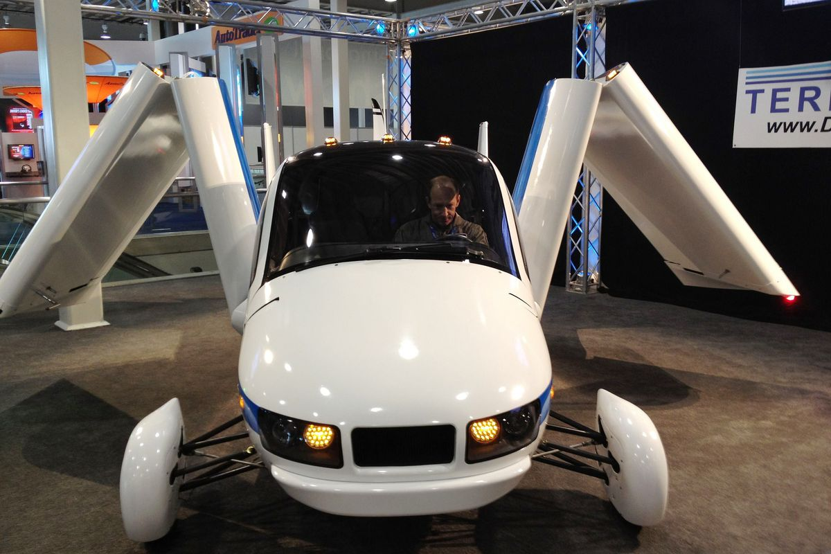 A flying car prototype with its wings folded into its body.