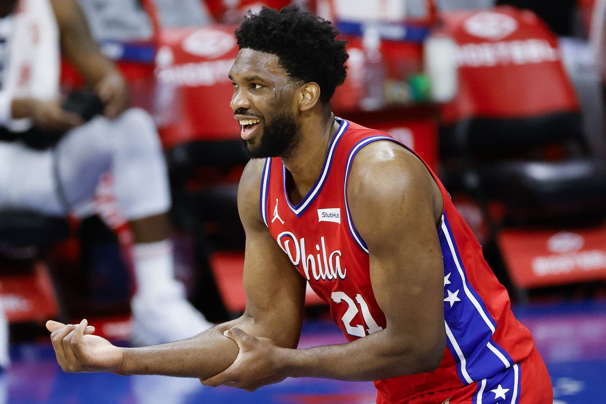 Joel Embiid of the Philadelphia 76ers reacts after scoring during the first quarter against the Utah Jazz at Wells Fargo Center on March 03, 2021 in Philadelphia, Pennsylvania.