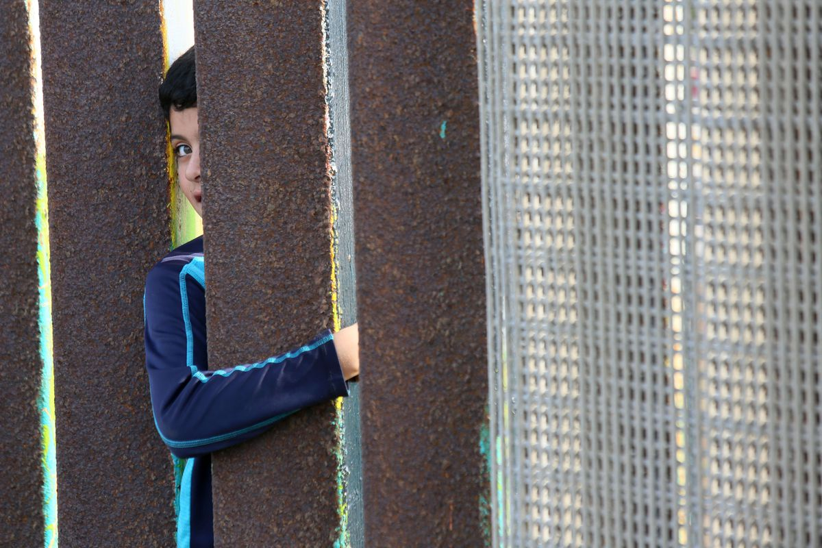 How donald trump could actually build the wall and who would pay a mexican boy reaches his arm through the border fence in san ysidro ca in 2016 sandy huffakerafp via getty malvernweather Images