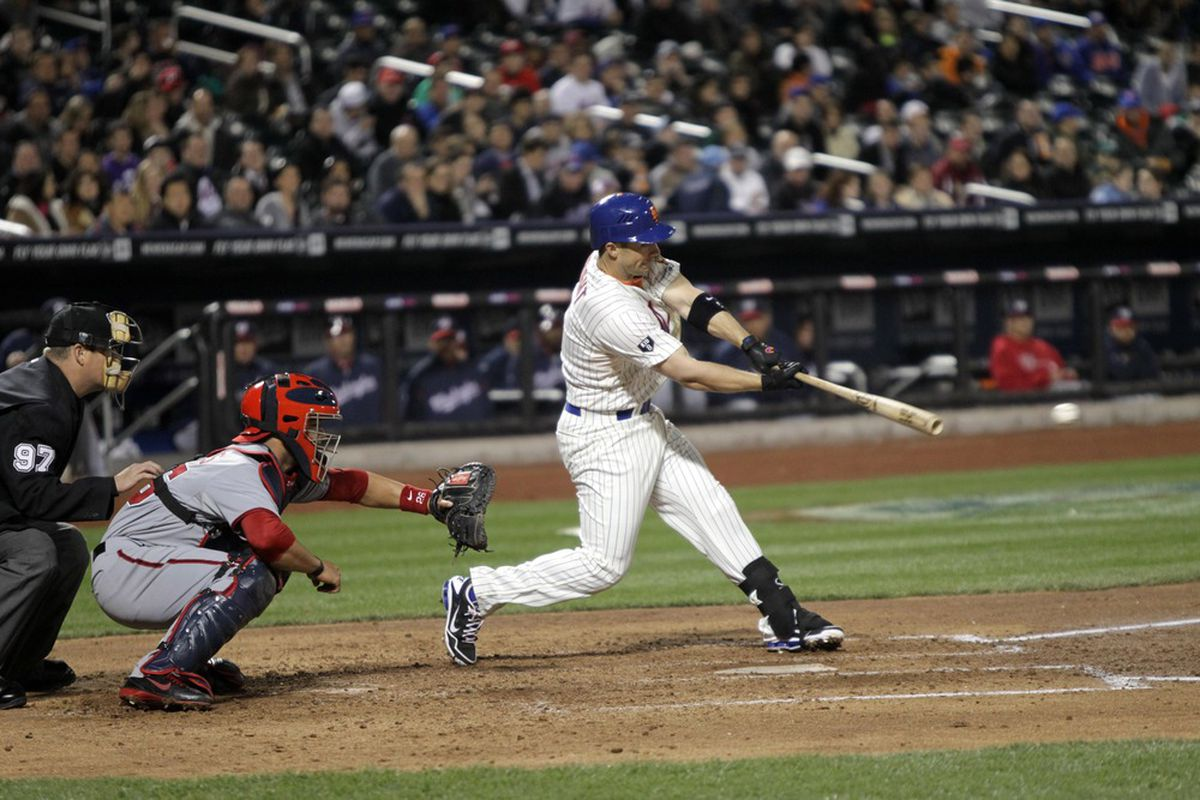 April 9, 2012; Queens, NY, USA; New York Mets third baseman David Wright (right) drives in a run during the third inning against the Washington Nationals at Citi Field. Mandatory Credit: John O'Boyle/THE STAR-LEDGER via US PRESSWIRE