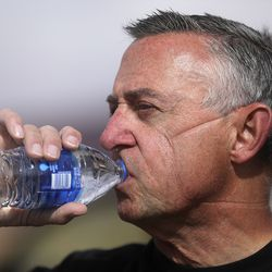 Andy Byrnes, a contracted emergency medical technician with the Utah Department of Health, takes a sip of water after taking off his N95 mask and Tyvek suit after administering COVID-19 tests outside of the Monument Valley Health Center in Oljato-Monument Valley, San Juan County, on Thursday, April 16, 2020. The mobile testing team tested 1,060 people in two days. The Navajo Nation has one of the highest per capita COVID-19 infection rates in the country.