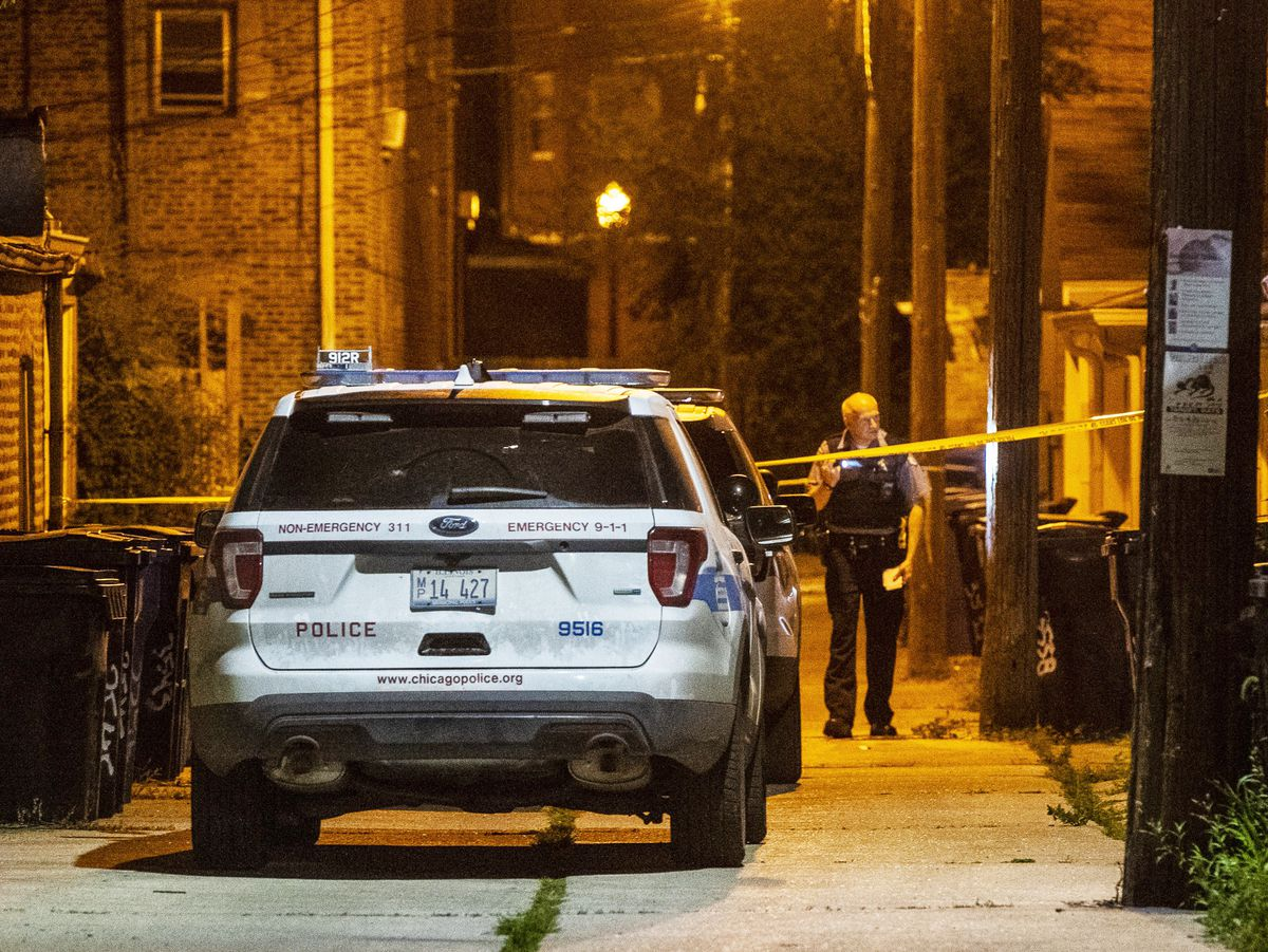 Police investigate an alley where a man was shot in the back Friday morning in the 3500 block of South Hoyne. A second scene thought to be related to this shooting was found a few block away in the 3200 block of South Hamilton.   Tyler LaRiviere/Sun-Times