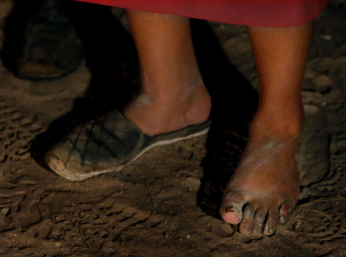 A woman from El Salvador seeking asylum stands at the border between Mexico and Texas on Tuesday, June 22, 2021.