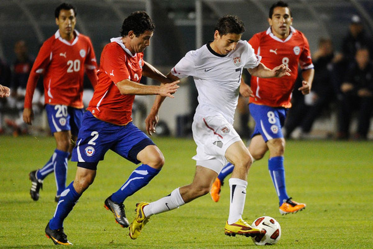 Alejandro Bedoya #7 United States is held by Eugenio Mena #2 of Chile against of the  during the friendly soccer match at The Home Depot Center on January 22 2011 in Carson California.  (Photo by Kevork Djansezian/Getty Images)