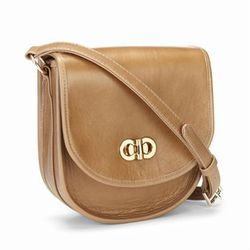 """The pale leather and rounded shape conjur easy '70s style. Lauren Merkin Stevie <a href=""""https://laurenmerkin.com/ItemDetails.aspx?ItemId=1705"""">cross-body bag</a>, $375."""