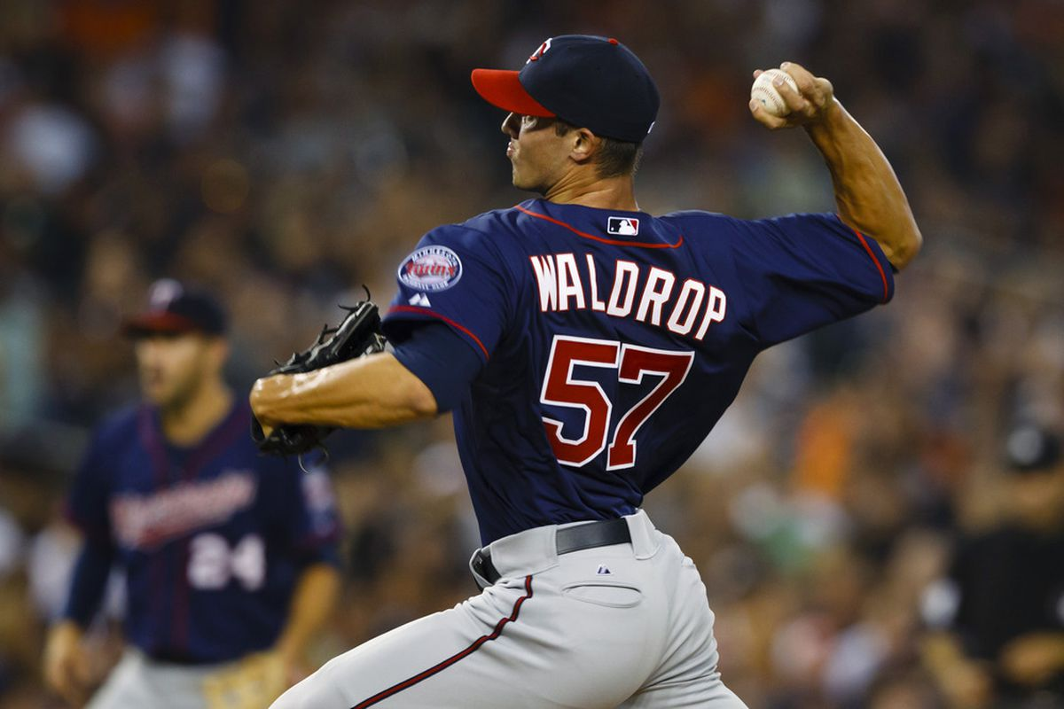 July 3, 2012; Detroit, MI, USA; Minnesota Twins relief pitcher Kyle Waldrop (57) pitches during the seventh inning against the Detroit Tigers at Comerica Park. Mandatory Credit: Rick Osentoski-US PRESSWIRE