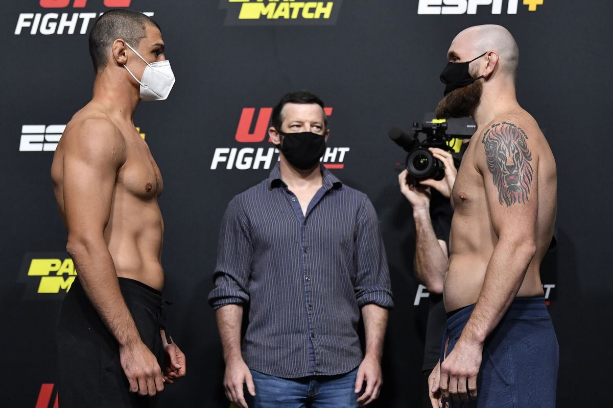 Opponents Alessio Di Chirico of Italy and Zak Cummings face off during the UFC Fight Night weigh-in at UFC APEX on August 28, 2020 in Las Vegas, Nevada.