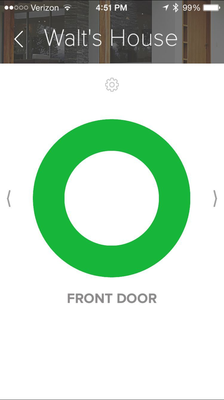 The August app uses a green circle to signal that the door is unlocked.