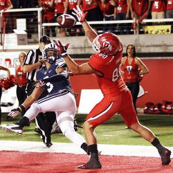 Utah Utes tight end Westlee Tonga (80) catches a touchdown over Brigham Young Cougars linebacker Kyle Van Noy (3)  in Salt Lake City  Saturday, Sept. 15, 2012.