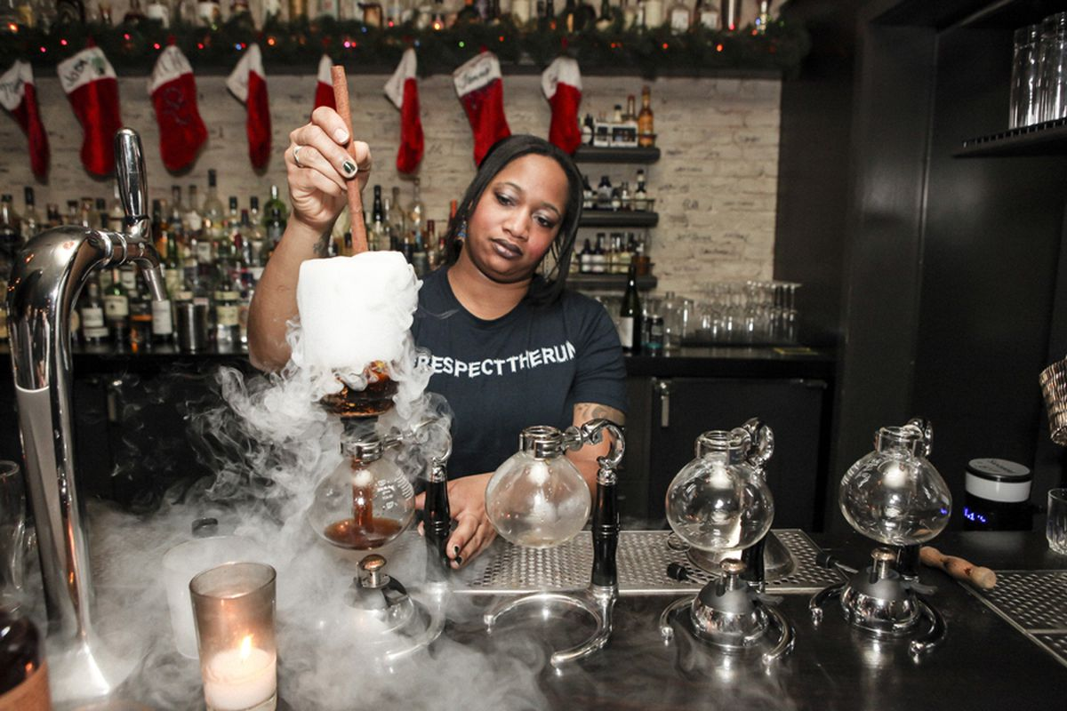 A bartender making a cocktail at Aviary's Los Angeles pop-up bar